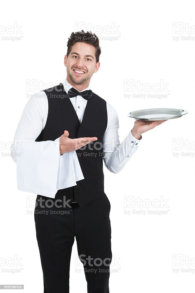 Confident Young Waiter With Napkin And Serving Tray stock photo