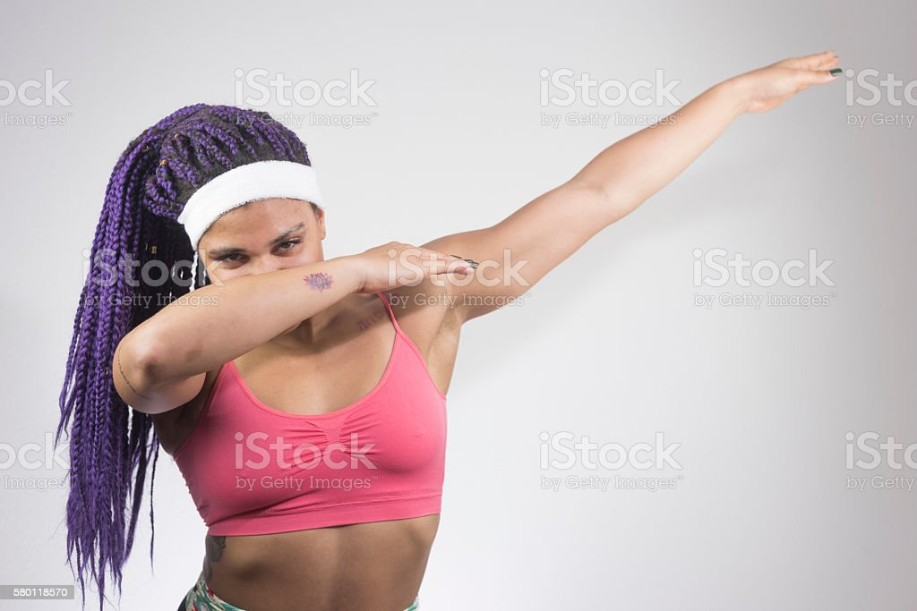 Confident Young Woman Doing The Dab Dance Move Stock Photo