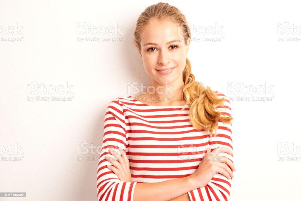 Confident young woman studio portrait стоковое фото