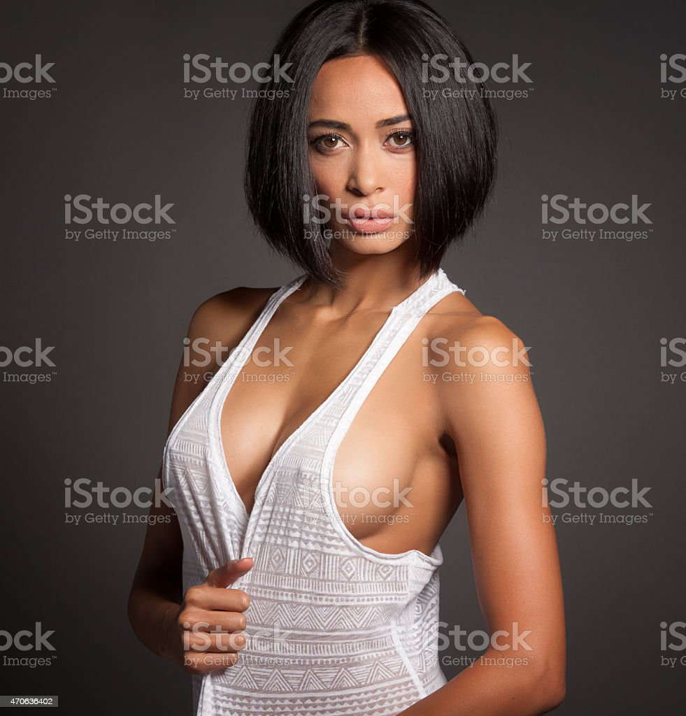 Confident Young Woman Wearing Sexy Tank Top stock photo
