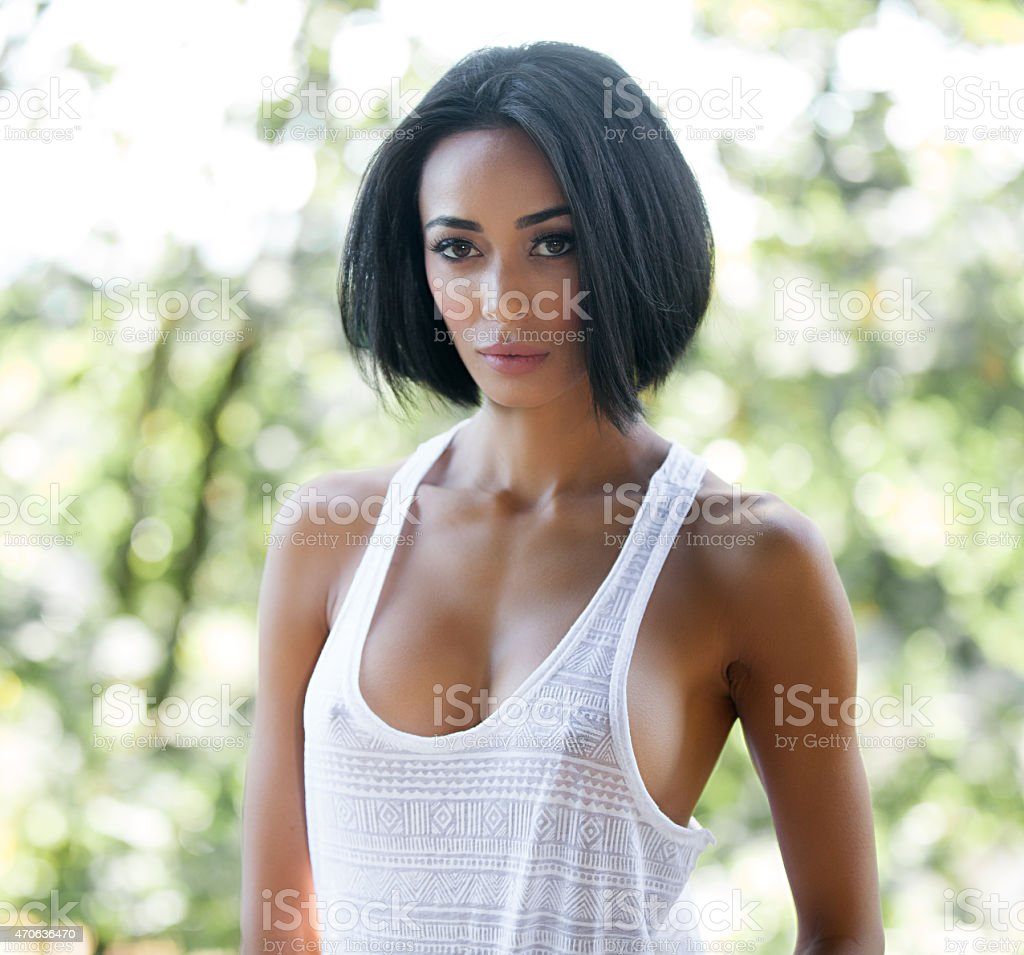 Confident Young Woman Wearing Sexy Tank Top​​​ foto
