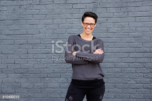 510397772 istock photo Confident young woman with glasses smiling 510400212