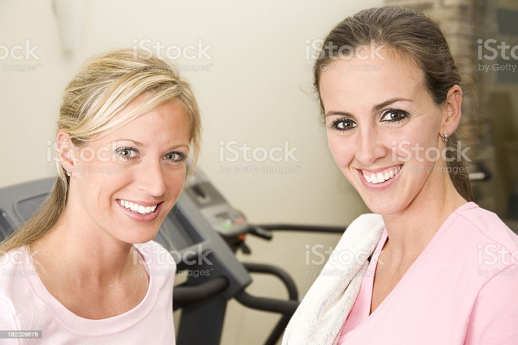 Confident Young Women at the Gym in front of treadmills royalty-free stock photo