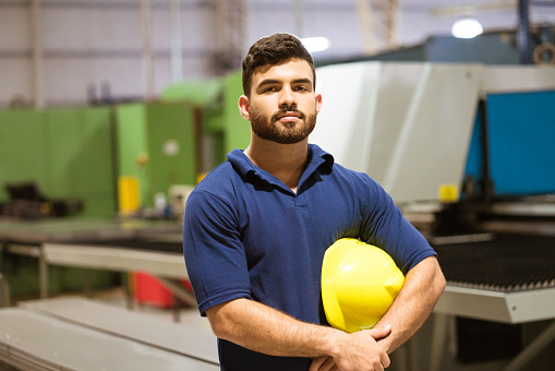 Confident Young Worker In Factory Stock Photo - Download Image Now