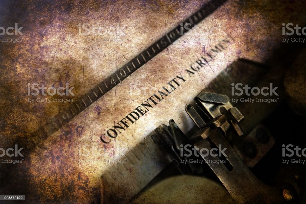 Confidential agreement on typewriter stock photo
