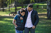Father and son in public park