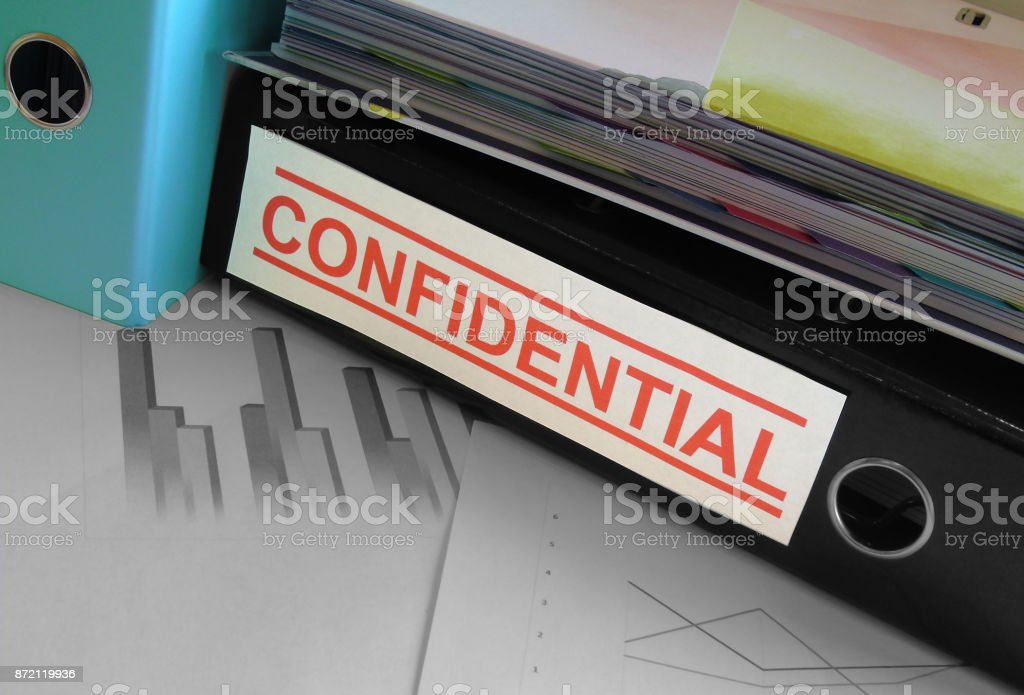 Confidential Files/Lever Arch Folders on Cluttered Desk - Data Protection Concept stock photo