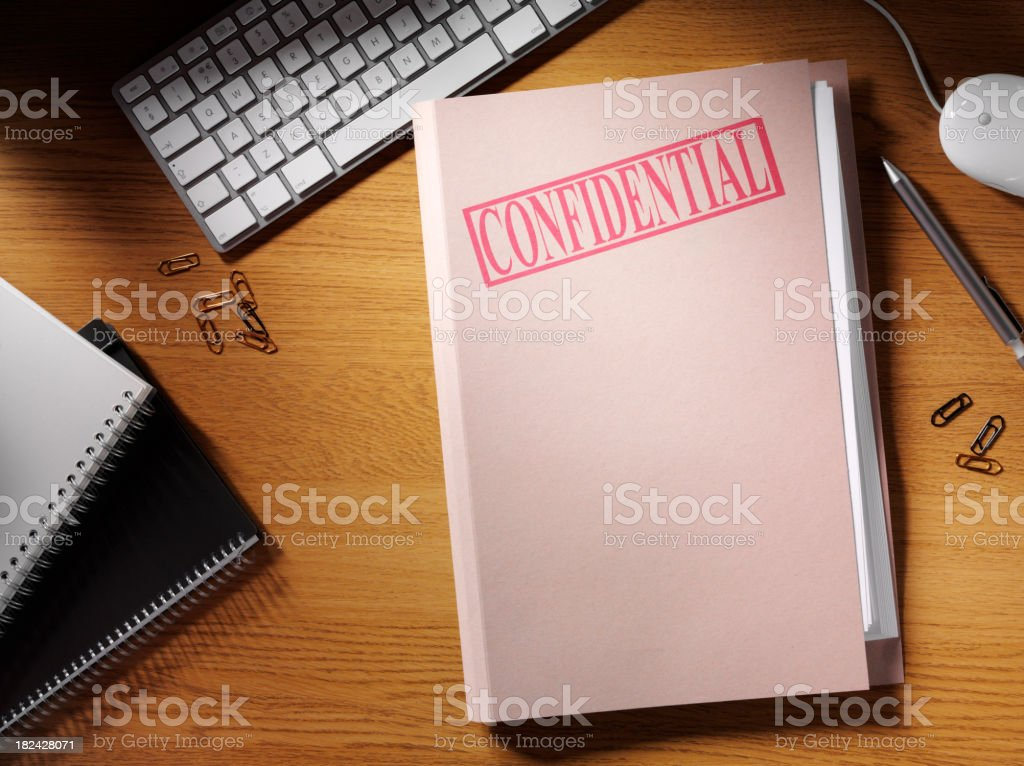 Confidential Folder on a Desk stock photo