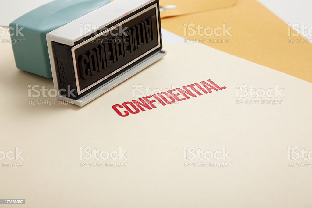 'Confidential' stamp on folders stock photo