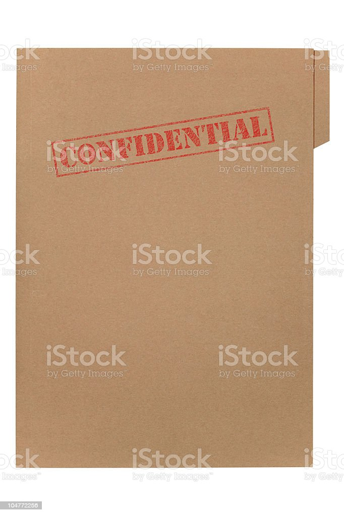Confidential stamped in red on a brown card folder royalty-free stock photo