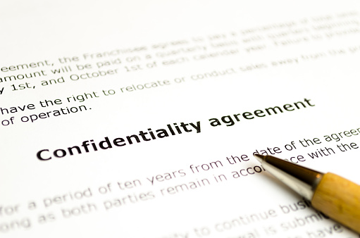 Confidentiality agreement with wooden pen