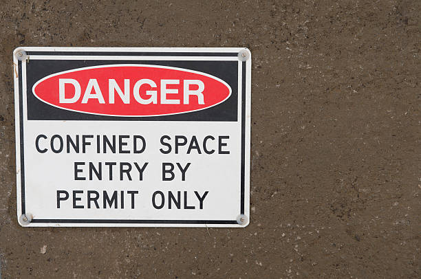 Confined Space Sign warning of dangerous work underway confined space stock pictures, royalty-free photos & images