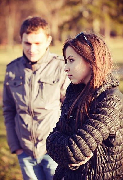 conflict and emotional stress in young couple stock photo