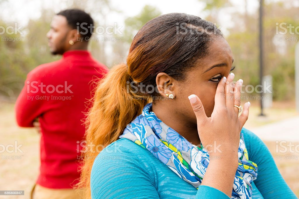 Conflict, arguement between African descent couple. Sadness, crying, anger. stock photo