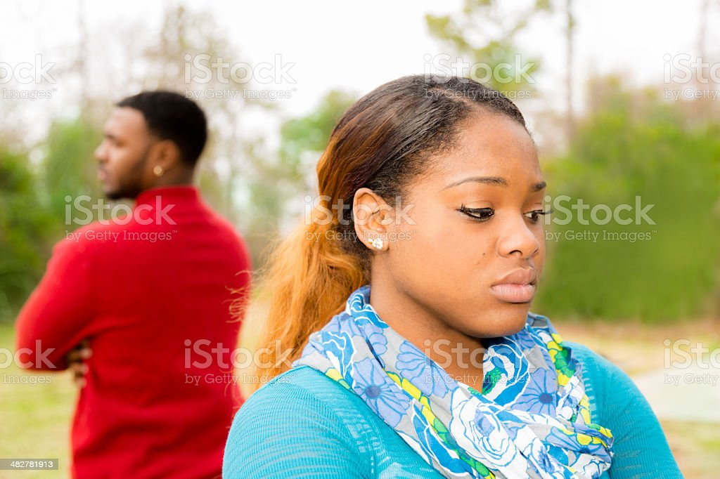 Conflict between a young African descent couple. Sadness, despair. stock photo
