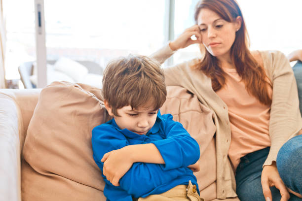 Conflict between mother and son stock photo
