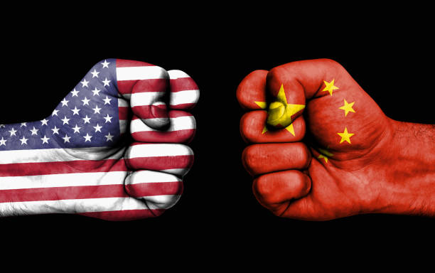Conflict between USA and China - male fists stock photo