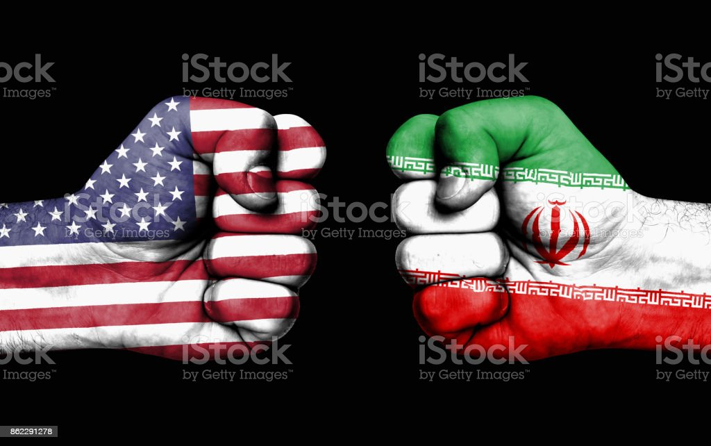 Conflict between USA and Iran - male fists stock photo