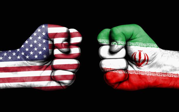 konflikt zwischen usa und iran - männliche fäuste - iranische stock-fotos und bilder