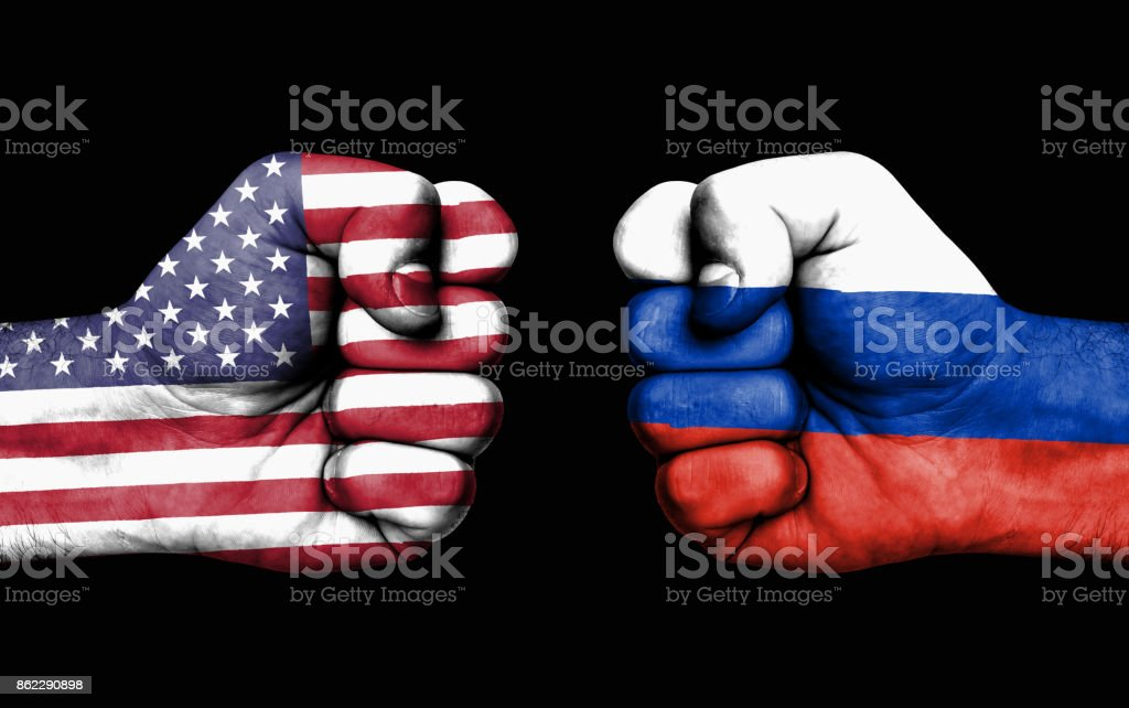 Conflict between USA and Russia - male fists stock photo