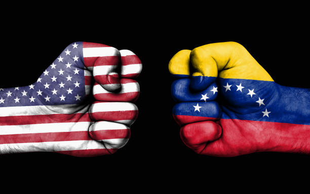 conflict between usa and venezuela - male fists - venezuelan flag stock photos and pictures