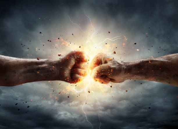 Conflict Concept - Two Fists In Impact Two Fiery Fists In Impact With Stormy Sky In Background aggressively stock pictures, royalty-free photos & images