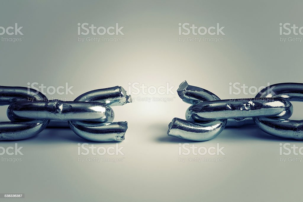 conflict in business concept with broken chain stock photo