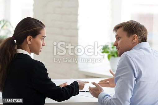 463813207 istock photo Conflict of female boss and male office worker 1138947305