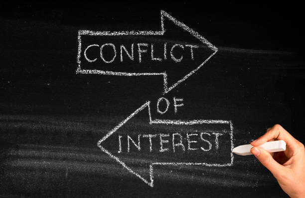 Conflict Of Interest Conflict Of Interest  concept on blackboard interest rate stock pictures, royalty-free photos & images