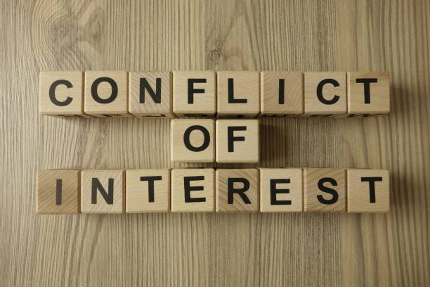 conflict of interest text from wooden blocks stock photo
