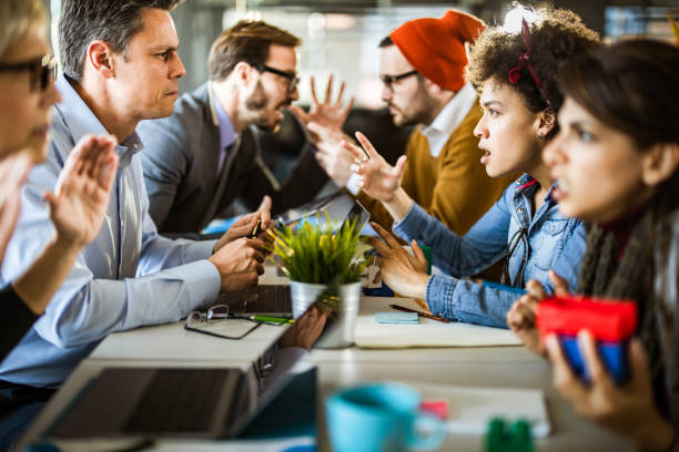 Confrontation among business people and creative people! stock photo
