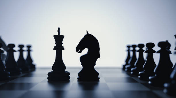 confrontation between the horse and the fattening of chess. stock photo