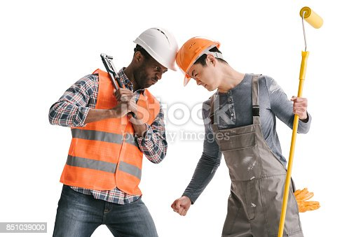 istock Confrontation of african-american and asian builders 851039000