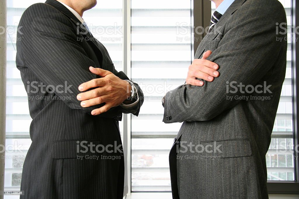 Confrontation of two businessman royalty-free stock photo