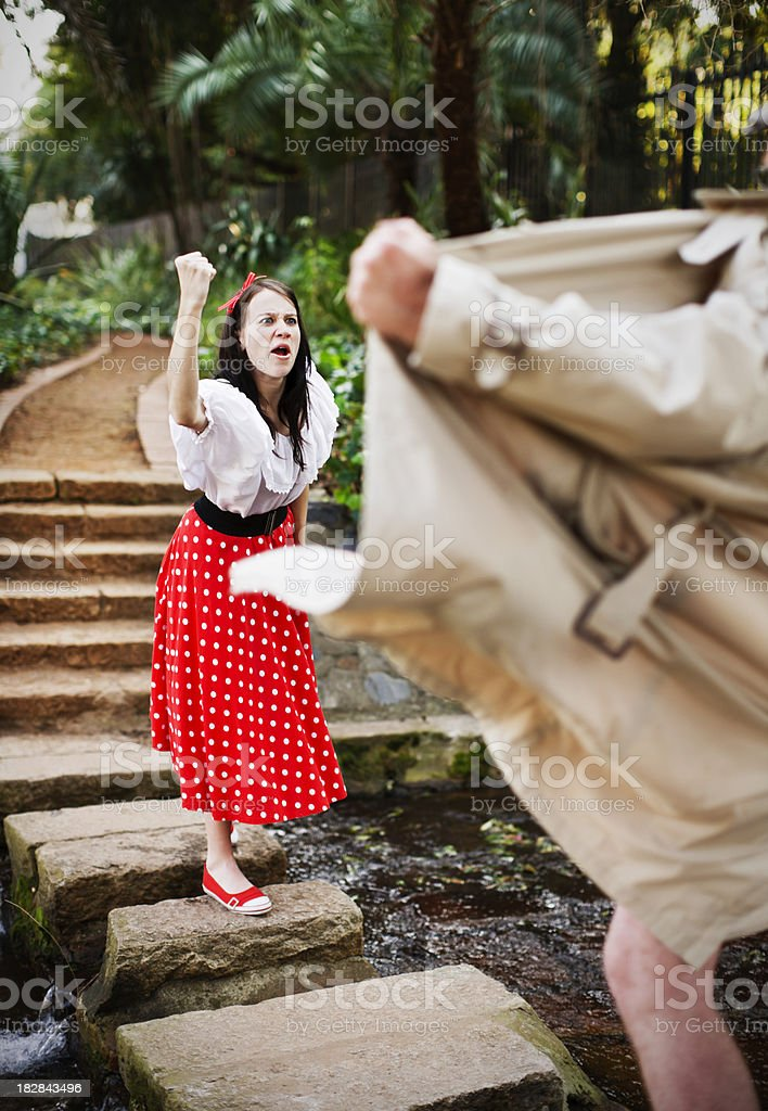 Confronted by a flasher, this girl shows defiance, shaking fist! royalty-free stock photo