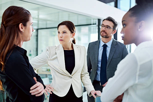 Confronting problems with colleagues is never a pleasant experience - foto de stock
