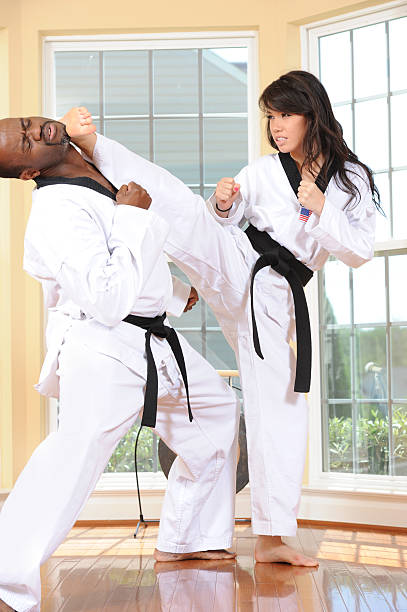 confronting side kick - karate stock photos and pictures