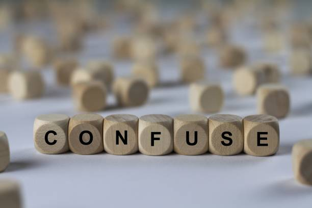confuse - cube with letters, sign with wooden cubes - disconcert stock pictures, royalty-free photos & images