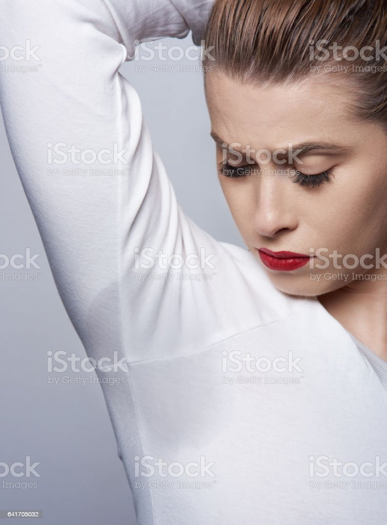 confused about my sweat armpint stock photo