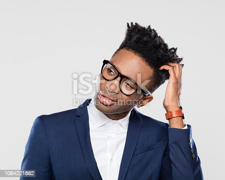 611876426 istock photo Confused afro american businessman looking away 1064221862