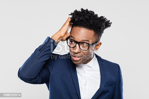 611876426 istock photo Confused afro american businessman looking away 1098232014