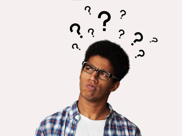 Confused Afro Guy Has Too Many Questions Confused Afro Guy Has Too Many Questions and No Answer, White Background ambiguity stock pictures, royalty-free photos & images