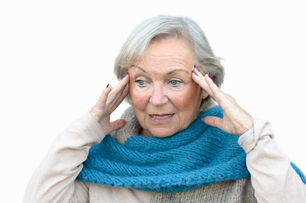 Confused and bewildered senior lady stock photo