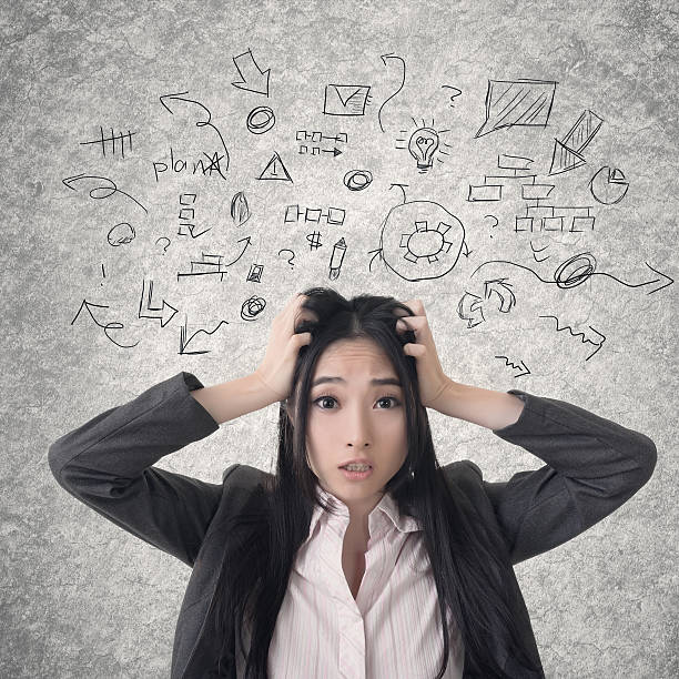 confused asian business woman - disconcert stock pictures, royalty-free photos & images