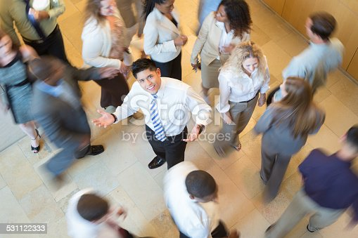 905689676 istock photo Confused Asian businessman lost in busy crowd of professionals 531122333