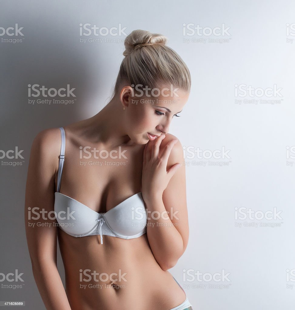 Confused Beautiful Blonde Posing In White Lingerie Stock Photo ... 681ace2c4
