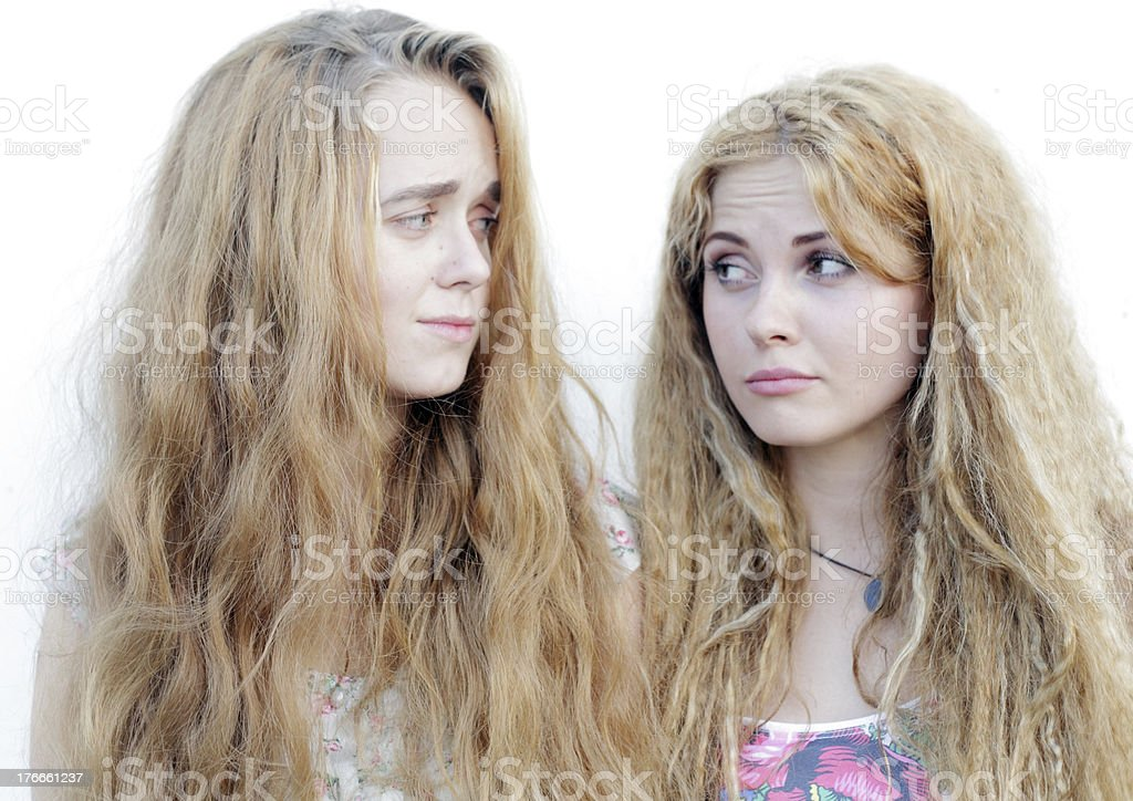 confused blond girls looking at each other royalty-free stock photo