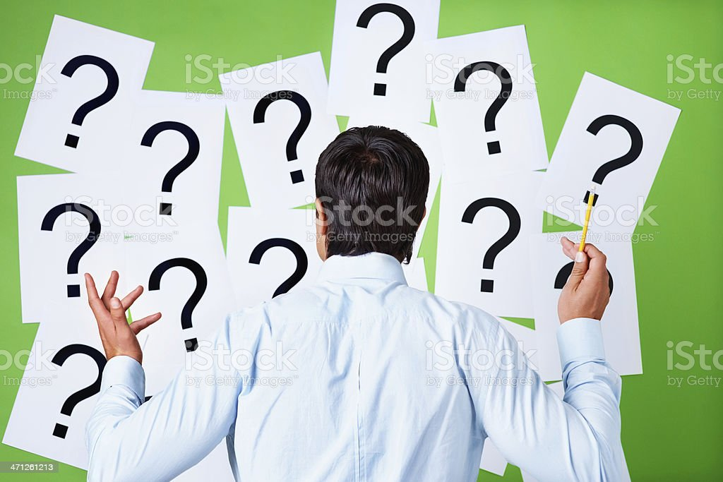 Confused business executive searching for a solution royalty-free stock photo