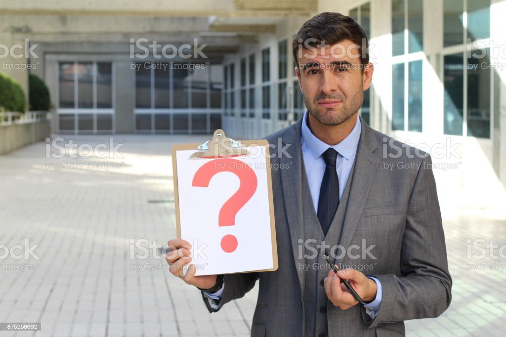 Confused businessman with a major question stock photo