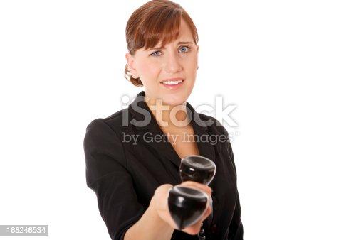 istock Confused Businesswoman holding telephone 168246534